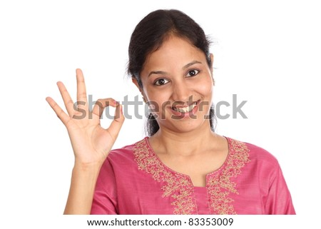 Young beautiful girl making Ok sign against white - stock photo