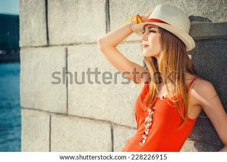Young beautiful girl near the wall - stock photo