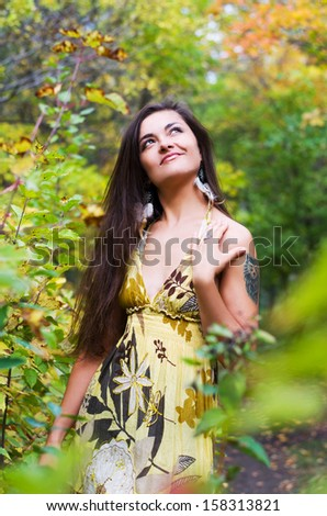 Young beautiful girl on a background of nature