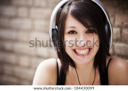 Young beautiful girl portrait wearing headphones. - stock photo