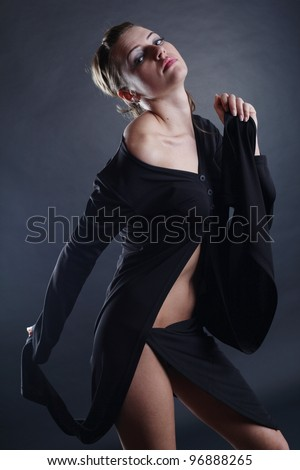 young Beautiful girl poses in studio