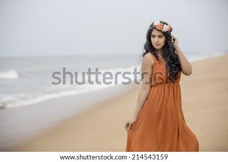 Young beautiful girl posing in the beach. - stock photo