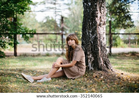 young beautiful girl posing in the park - stock photo