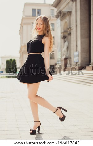 young beautiful girl posing in the street