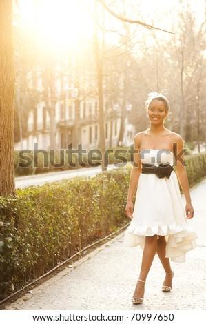Young beautiful girl posing in white dress - stock photo