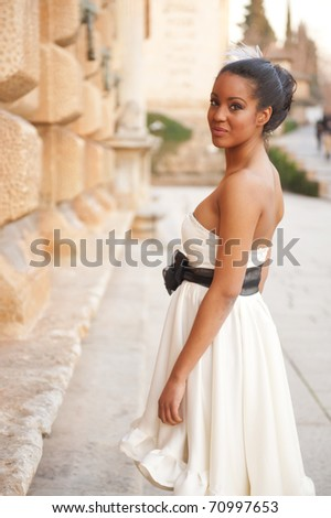 Young beautiful girl posing in white dress - stock photo