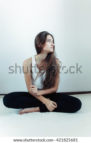 young beautiful girl posing on a white background