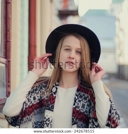 young beautiful girl posing on the street - stock photo