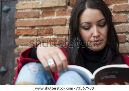 Young beautiful girl reading - stock photo