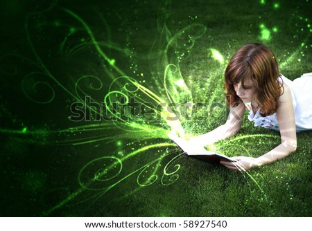Young beautiful girl reading a book outdoor - stock photo