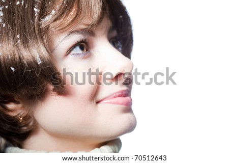 young beautiful girl rejoices to snow - stock photo