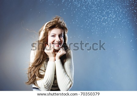 young beautiful girl rejoices to snow, On a dark blue background