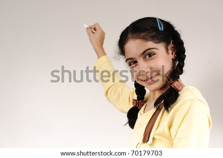 young beautiful girl standing by the board writing your text - stock photo