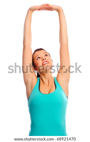 Young beautiful girl stretches her muscles, isolated on white