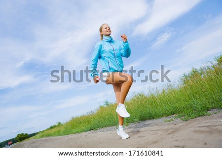 Young beautiful girl training outdoor in summer