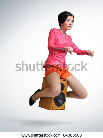 Young beautiful girl unreal flies on speaker, motorcycle stylize concept