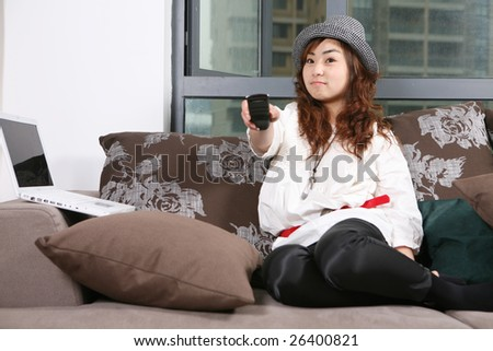 young beautiful girl use pc at home - stock photo