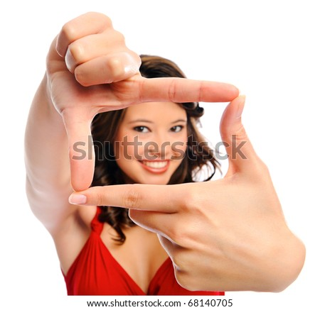 Young beautiful girl using her fingers to frame an imaginary picture
