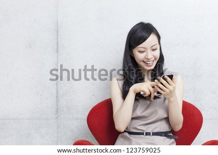 young beautiful girl using smart phone - stock photo