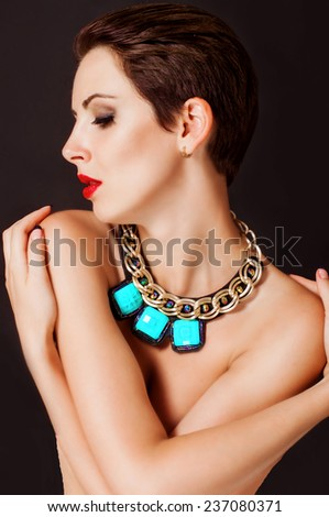 Young beautiful girl with a  big jewelry