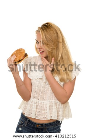 young beautiful girl with a Burger in hand isolated on white background - stock photo