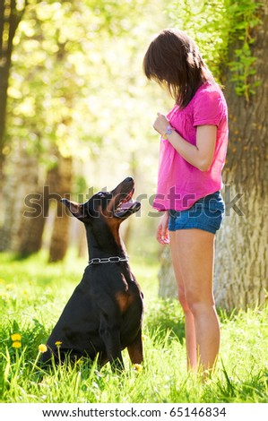 Young beautiful girl with a dog