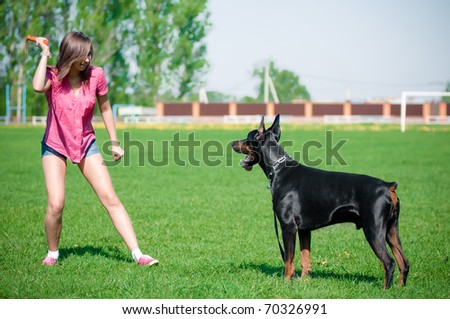 Young beautiful girl with a dog - stock photo