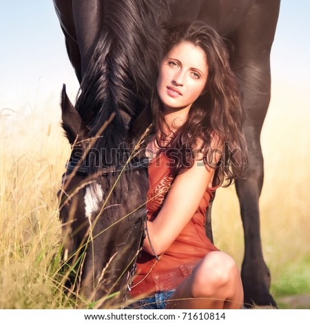 Young beautiful girl with a horse - stock photo