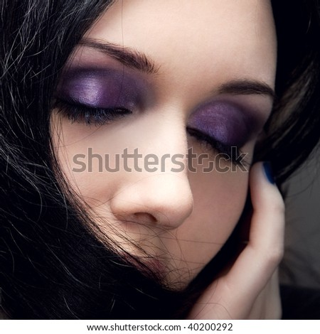 young beautiful girl with a make-up in violet tones
