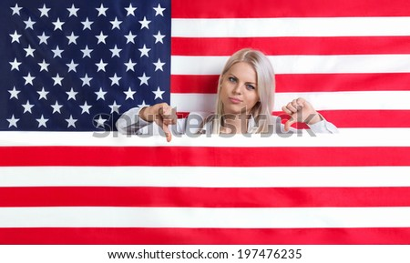 Young beautiful girl with American flag - stock photo