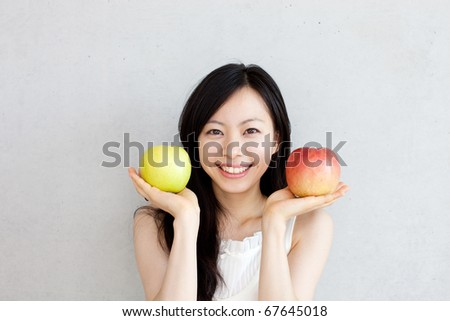 young beautiful girl with apples