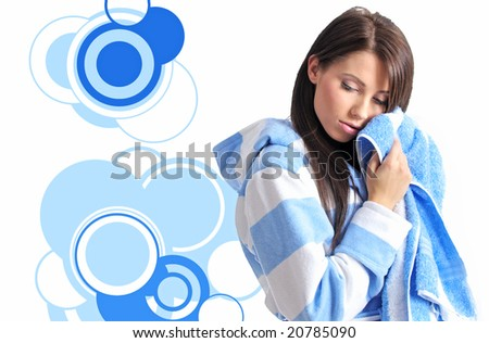 Young beautiful girl with bath towel over abstract round modern design background - stock photo
