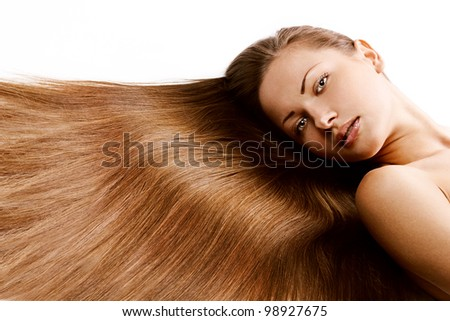 young beautiful girl with beautiful long brown healthy shiny hair