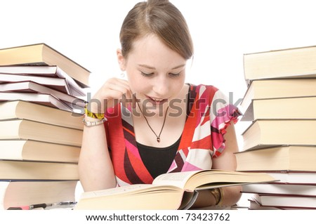 Young beautiful girl with blond hair is sitting at home on the desk with books and learn. Isolated on white background - stock photo
