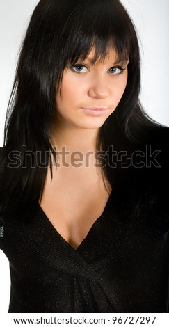 young beautiful girl with dark hair and a black dress