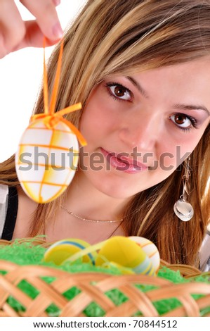 Young beautiful girl with easter egg in her hand