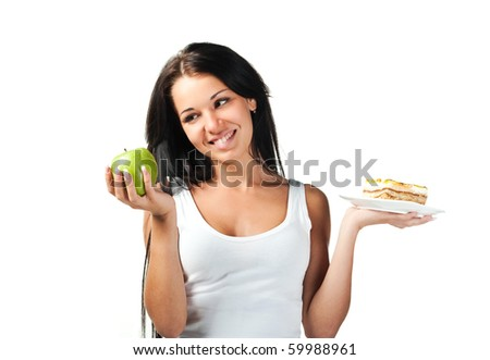 Young beautiful girl with fruit and cake in her hands - stock photo