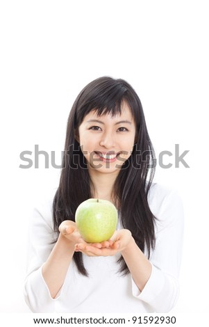 young beautiful girl with green apple isolated on white background - stock photo