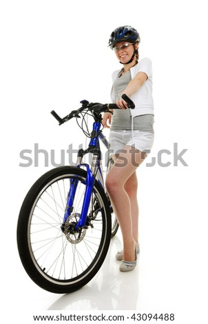 Young beautiful girl with her bike - stock photo