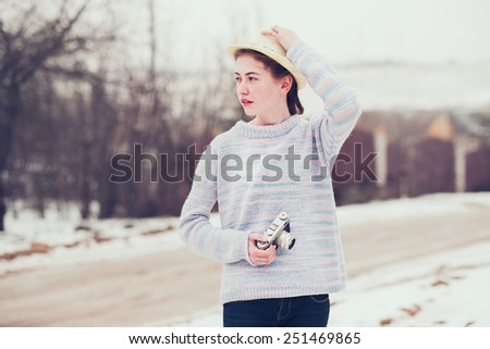 young beautiful girl with hipster vintage camera. Photo of the journey in the countryside - stock photo
