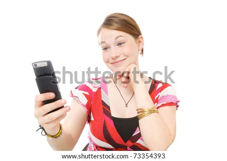Young beautiful girl with long blond hair has fun on the phone. Isolated on white background