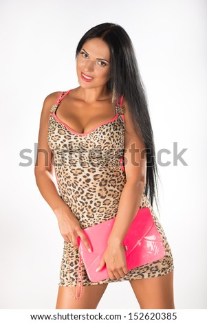 Young, beautiful girl with long hair posing in the studio