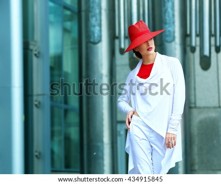 Young beautiful girl with perfect make-up, red lips, wearing a red  hat - stock photo