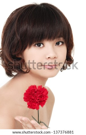 young beautiful girl with perfect skin and a carnation - stock photo