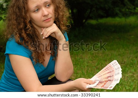 Young beautiful girl with Russian money - Roubles - stock photo