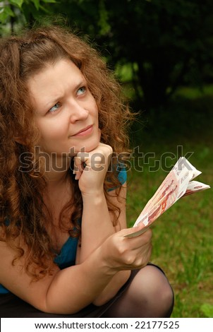 Young beautiful girl with Russian money - Rubles - stock photo
