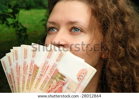 Young beautiful girl with Russian money - Rubles