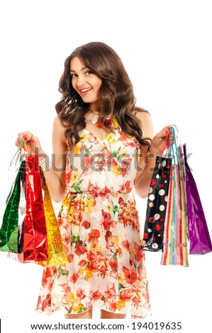 Young beautiful girl with shopping bags on white background isolate - stock photo