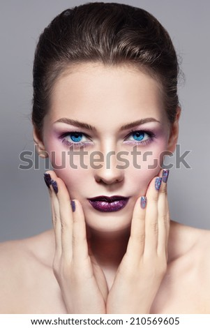 Young beautiful girl with stylish make-up and sparkly manicure - stock photo