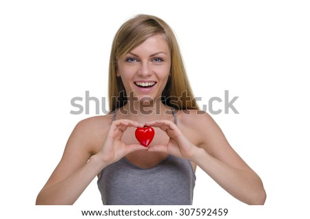 young beautiful girl with toy heart isolated on white background